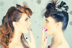 Absolutely Gorgeous Twins Girls with Fashion Make-up and Hairstyle. Surprised Gorgeous Twins Girls looking at Fashion Hairstyle for a Party at Night Club stock photography