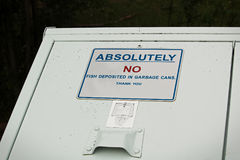 Absolutely no fish deposited in garbage can sign.  Stock Images