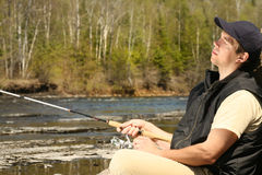 Absolutely relaxed fisherman Royalty Free Stock Image
