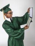 Absolvent mit Diplom stockfotografie