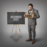 Absorbed cost text on blackboard with businessman Stock Photo