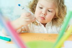 Absorbed in drawing Stock Photo