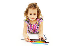 Absorbed little girl drawing with colorful pencils Stock Photo