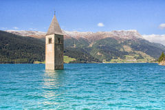 Absorbed tower in the Reschensee Royalty Free Stock Image