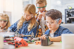 Absorbedly working children in workshop Stock Photo