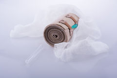 Absorbent gauze, bandage, and injection placed on white backgro. Absorbent gauze, bandage, and injection placed on a white background stock photo