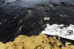 Absorbent paper used for lining oil from  crude oil spilled. Absorbent paper used for lining clean up oil from  crude oil spilled Stock Image