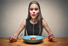 Absorbing paste. Young woman by absorbing paste from the dish stock photos