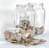 Absorption of a large small Bank. The concept of financial absorption of small banks large in the form of small banks with money in a large glass Bank stock images