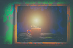 Absract color with A red cup in the picture frame. Royalty Free Stock Photography