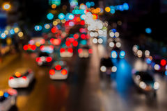 Abstact blur bokeh of Evening traffic jam on road in city.  Royalty Free Stock Images