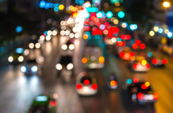 Abstact blur bokeh of Evening traffic jam on road in city.  Royalty Free Stock Photo