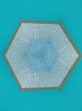 Abstact kaleidoskopefoto av tegelplattor på blå bakgrund Royaltyfri Foto