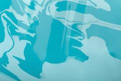 Abstact målning med blandningen av blåa vätskefärger Fotografering för Bildbyråer