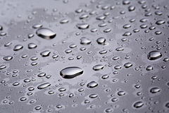 Abstact water drops on poniched stainless steel surface Royalty Free Stock Photo