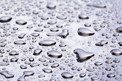 Abstact water drops on poniched stainless steel surface Royalty Free Stock Photography
