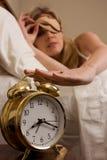 Abstellen der Alarmuhr Stockfotos