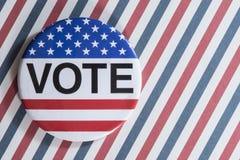 Abstimmungsknopf auf Streifen Stockfotos