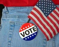 Abstimmungsknopf und -flagge in der Tasche Lizenzfreies Stockbild