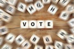 Abstimmungswahlpolitikwürfel-Geschäftskonzept stockbilder