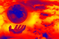 Abstrac with hands and planet. Abstract scene of the hands of the person keeps brighten planet on background cloud Stock Image