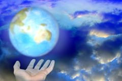 Abstrac with hands and planet. Abstract scene of the hands of the person keeps brighten planet on background cloud Stock Photo
