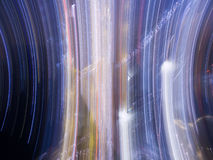 Abstrac lights vertical 02. Abstract background of city colorful night lights moving in circle Royalty Free Stock Image