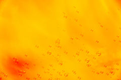 Abstrack background in orange with soap bubbles Royalty Free Stock Photos