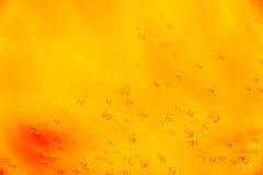 Abstrack bakgrund i apelsin med såpbubblor Royaltyfria Foton