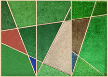 Abstrack wall background from multicolor artificial grass in woo