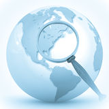 Abstract 3d illustration of earth globe. (Europe) with magnify glass Royalty Free Stock Images