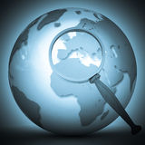Abstract 3d illustration of earth globe. (Europe) with magnify glass Stock Photography