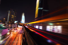 Abstract acceleration speed motion light Blur from Sky Train at night Royalty Free Stock Photo