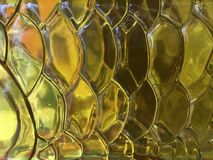 Abstract achtergrond geel kleurenglas en licht Stock Afbeelding
