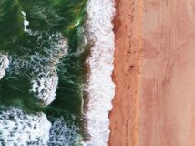 Sandy Beach and Waves from Above. Abstract Aerial View of Sandy Beach and Small Waves from Above royalty free stock image