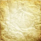 Grunge texture of old crumpled brown paper, creases, stains, dir. Abstract aged ancient antique art Royalty Free Stock Photo
