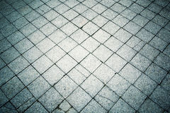 Abstract aged cracked geometric stone tiles background Royalty Free Stock Photo
