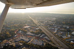 Abstract Airplane View of Highway and Sun. Aerial shot of sunset from pilot's perspective from a small airplane Royalty Free Stock Image