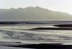 ABSTRACT- Alaska- Anchorage Bay Panorama. The bright afternoon light over the mud flats near Anchorage, Alaska creates a beautiful abstract background stock images