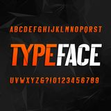 Abstract alphabet typography. Oblique type letters and numbers on a dark polygonal background. Vector font for your design Royalty Free Stock Photography