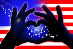 Abstract american flag design with heart. Abstract american flag design with man hands in heart shape Royalty Free Stock Photo