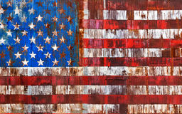 Abstract american national flag on metal. Abstract image of the american flag on a rusty fence Royalty Free Stock Photos