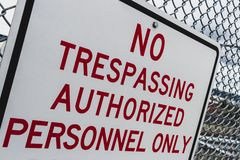 Abstract angle no trespassing authorized personnel sign stock image