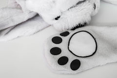 Abstract animal paw, part of clothes Royalty Free Stock Images