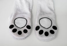 Abstract animal paw, part of clothes Stock Images