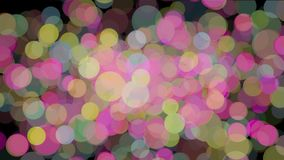 Abstract animation of many colored particles of bubbles floating chaotically and blinking on the black background