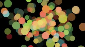 Abstract animation of many colored particles of bubbles floating chaotically and blinking on the black background stock photo