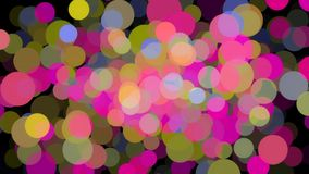 Abstract animation of many colored particles of bubbles floating chaotically and blinking on the black background royalty free stock photo