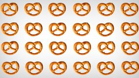 Animation of pretzel. Different directional orientations a white background. Abstract animation of salted pretzel. Different directional orientations, vibrating stock video