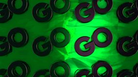 Abstract animation of threedimensional chrome logotypes `Go` placing on green surface. Animation. Motivation and logos